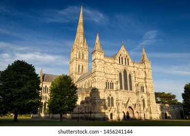 Great West Front facade of Salisbury Cathedral in late evening light in Salisbury England
