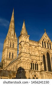 Great West Front facade of Salisbury Cathedral with Spire in late evening light in Salisbury England