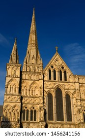 Great West Front facade of Salisbury Cathedral with Spire in gold evening light in Salisbury England