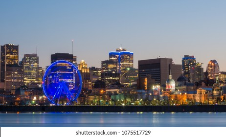 Great wheel of Montreal - Long exposure - and a breathtaking view of the river, Old Montreal and downtown city during the evening