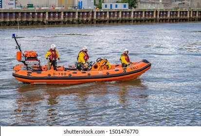 Great Yarmouth, Norfolk, UK – September 08 2019. Great Yarmouth and Gorleston onshore lifeboat complete with three male crew members coming in to moor up at Yarmouth port