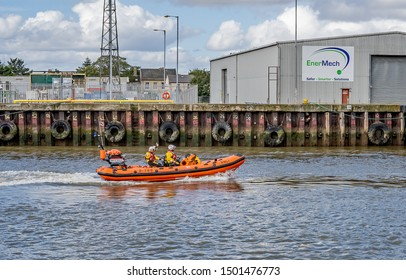 Great Yarmouth, Norfolk, UK – September 08 2019. Caister onshore Lifeboat RIB sailing off down the river during the Yarmouth Maritime Festival