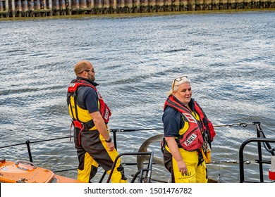 Great Yarmouth, Norfolk, UK – September 08 2019. A male and female member of Great Yarmouth and Gorleston RNLI lifeboat crew standing on board the deck of the offshore lifeboat