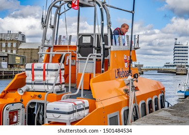 Great Yarmouth, Norfolk, UK – September 08 2019. A close up of Great Yarmouth and Gorleston offshore RNLI lifeboat and one of the crew on deck at the Yarmouth Maritime Festival