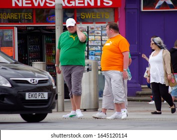 Great Yarmouth, UK 06/12/2015 Three fat men waiting to cross the road