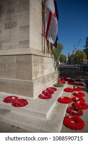 Greater London, London, UK - May 5 2018 : Poppy wreath tributes to the fallen on the steps of the Cenotaph remembrance war memorial in Whitehall, London, designed by Edwin Lutyens