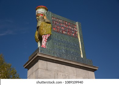 Greater London, London, UK - May 5 2018 : The Fourth plinth in Trafalgar Square, London, featuring 'The Invisible Enemy Should not Exist' statue made up of artefacts looted from Iraq during the war