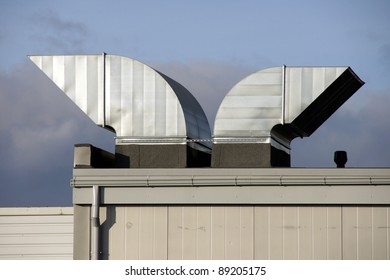 Greater pipes of ventilation on a background of clouds