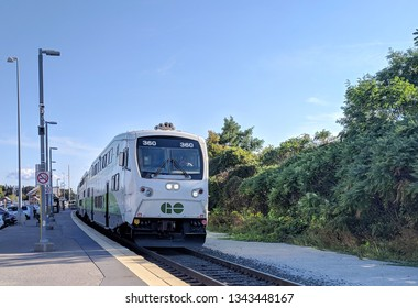 Greater Toronto Area, Ontario / Canada - September 19, 2018: Go Train arrives at Maple GO Train station. Local GTA Train transport transit. Sunny day, clear blue sky.