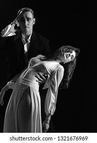 Greatest love story. Mime man and woman act in romantic scene. Couple of mime artists perform romance on stage. Couple in love with mime makeup. Theatre actors miming through body motions.
