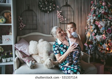 great-grandmother with a baby in a Christmas tree