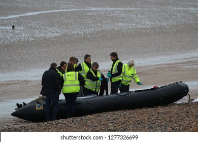 Greatstone, Kent, Great Britain - 31st December 2018. UK Border force & National Crime agency officers investigates a small rib on the beach There are reports that this craft contained 12 migrants