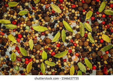 Gree, red, black peppers texture, close up. BBQ spices mix with sea salt, black pepper corns, cardamom, coriander, mustard corns, mild-peppery pink berries for pepper mill.