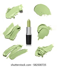 Gree texture and smears of crushed lipstick. Green Lipstick isolated on a white background