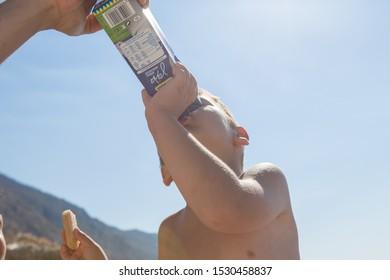 Greece 26 Jul 2019 - Little  boy drinking a carton of milk