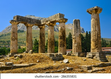 Greece. Ancient Corinth. The Doric temple of Apollo (6th century BC); in the background - Acrocorinth with fortified citadel formed on the top of rock