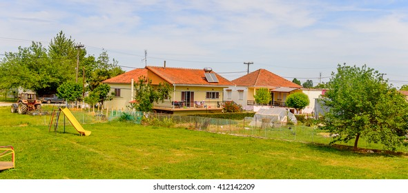 GREECE - APR 22, 2016: House in a village in Greece. Greece has a lot of green beautiful countrysides