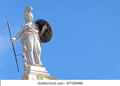 Greece, Athena the goddess of knowledge and wisdom statue, space for typing on blue sky