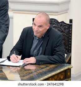 Greece, Athens, Jan. 27, 2015. New Greek Finance Minister Yanis Varoufakis signs a protocol after the swearing in ceremony at the Presidential Palace.