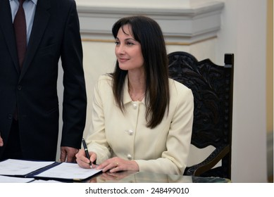 Greece, Athens, Jan. 27, 2015. New Greek Deputy Minister for Tourism Elena Kountoura signs a protocol after a swearing in ceremony at the Presidential Palace in Athens.