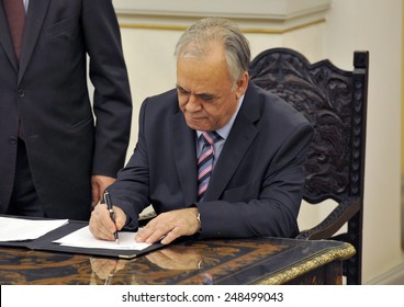 Greece, Athens, Jan. 27, 2015. Greece's Deputy Prime Minister Giannis Dragasakis signs a protocol after the swearing in ceremony at the Presidential Palace.