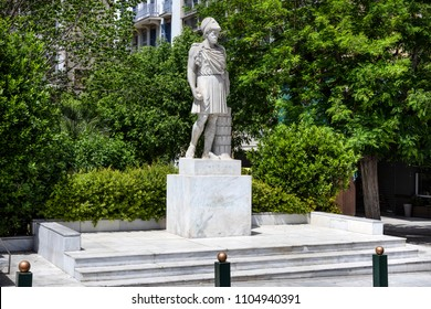 Greece, Athens, Kotzia Square: Statue sculpture of prominent and influential statesman Pericles on the right side of the famous City Hall in the city center of the Greek capital with blue sky.
