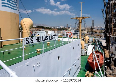 Greece, Athens, Piraeus: Side view detail of historic cargo ship S.S. Hellas Liberty in the famous harbor of the Greek capital - concept floating maritime museum navigation shipping. April 27, 2018