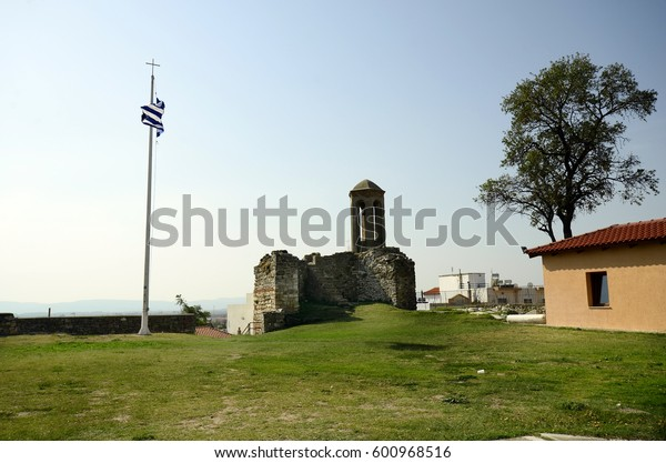 Greece, bell tower of byzantine church of the Monastery of Panagia Kosmosoteira and Greek flag