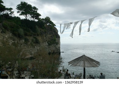 Greece, Cameo Island, Agios Sostis, Zakynthos - 21 September 2008: the most picturesque place in Laganas Bay, with pine trees growing in the rocks and  white cloth blowing in the wind.