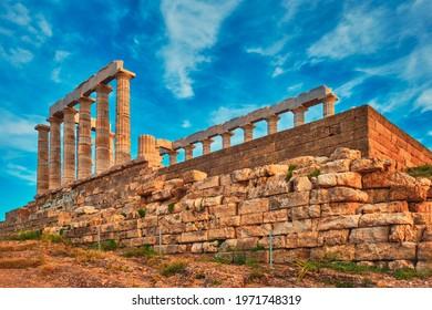 Greece Cape Sounio. Ruins of an ancient temple of Poseidon, Greek god of the sea, on sunset. Shot of temple ruins on sunset. Tourist landmark of Attica, Sounion, Greece