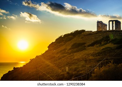 Greece Cape Sounion. Ruins of an ancient temple of Poseidon, Greek god of the sea, at sunset. Travel destinations.
