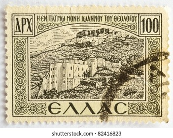 GREECE - CIRCA 1947: a 100d stamp from Greece (catalogue number Scott 2008 509) shows image of the Monastery where St John preached at Patmos, circa 1947