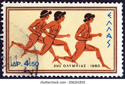 """GREECE - CIRCA 1960: A stamp printed in Greece from the """"Olympic Games, Rome"""" issue shows sprinting, circa 1960."""