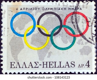 GREECE - CIRCA 1968: A stamp printed in Greece issued for 6th April, Olympic day shows Olympic Rings and globe, circa 1968.