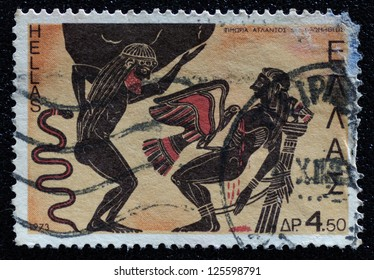 GREECE - CIRCA 1973: A stamp printed in Greece shows Atlas and Prometheus punished by Zeus, circa 1973.