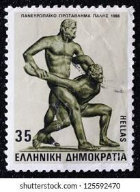"""GREECE - CIRCA 1986: A stamp printed in Greece shows ancient sport """"Wrestling"""" , circa 1986."""