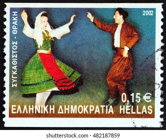 "GREECE - CIRCA 2002: A stamp printed in Greece from the ""Greek Dances"" issue shows Synkathistos dance, Xanthi, circa 2002."