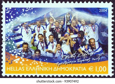 """GREECE - CIRCA 2004: A stamp printed in Greece from the """"Greece, European football champion 2004"""" issue shows the Greek football national team, circa 2004."""