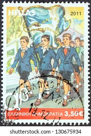 """GREECE - CIRCA 2011: A stamp printed in Greece from the """"Primary School Reading Books"""" issue shows cover of the 5th grade reading book, circa 2011."""