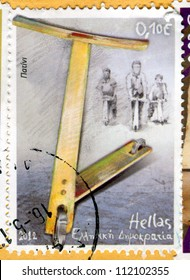 GREECE - CIRCA 2012 stamp printed by Greece, shows children and scooters, circa 2012