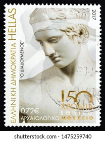 """GREECE - CIRCA 2017: A stamp printed in Greece from the """"150th Anniversary of the National Archaeological Museum of Athens"""" issue shows Diadoumenos statue, circa 2017."""