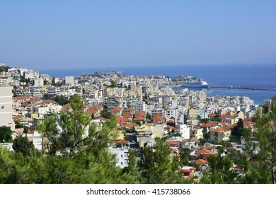 Greece, cityscape of Kavala with fortress, harbor and cruising ship