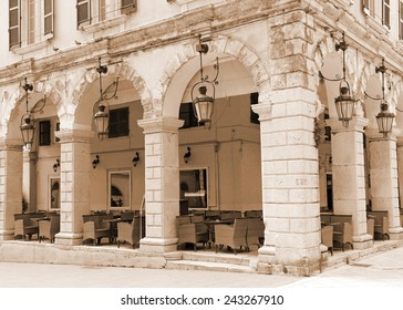 Greece. Corfu (Kerkyra) island. Corfu town. An open-air cafe. In sepia toned