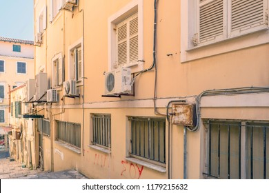 GREECE - CORFU - CORFU TOWN - JULY 31, 2018: Alley in Corfu Town (Kerkyra) with air conditioners and electricity cables in Greece.