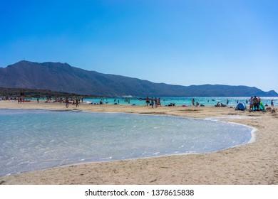 Greece, Crete, August 2018: Tourists on the beach of Elafonisi in Crete. Most popular tourist destination
