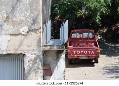 Greece, Crete - August 26: Vintage Toyota truck in Crete on August 26, 2018. Toyota Motor Corporation, usually shortened to Toyota, is a Japanese multinational automotive manufacturer.