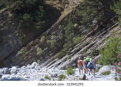 GREECE, CRETE, JUL 10: Tourist  walking in a mountain gorge of Samaria on Jule 10, 2015