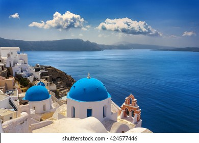 Greece. Cyclades Islands - Santorini (Thira). Oia town with typical Cycladic architecture - painted blue cupolas and white walls of houses. The Anastasis Church