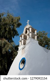 Greece, Cyclades, Mykonos, Hora. Typical whitewashed church rooftop with bell tower showing traditional Cycladic architecture. .