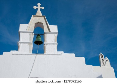 Greece, Cyclades, Mykonos, Hora. Typical whitewashed church rooftop with bell (circa 1811) tower showing traditional Cycladic architecture. .